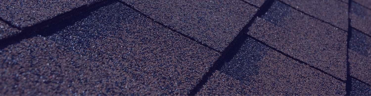 A close-up macro shot of asphalt shingles, showcasing our roof repair work as storm repair contractors.